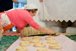 "November 2014. ...stamping breads with ""typari"". It took place during the workshop ""Traditional wedding's sweet ""melekouni"" and bread of the Archangelos village"". Host: Traditional house ""Tsampika"". Archangelos Rhodes."