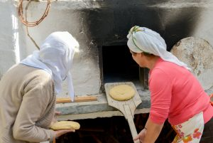 "Summer 2014 ...baking traditional bread. From the cultural activities of ""Two arch type houses in Archangelos Rhodes - Ambassadors of Hellenic Culture."