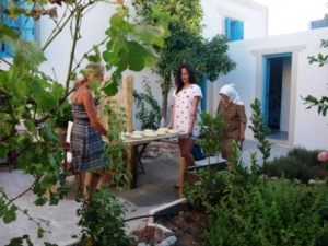 "Summer 2014...baking traditional bread. From the cultural activities of ""Two arch type houses in Archangelos Rhodes - Ambassadors of Hellenic"