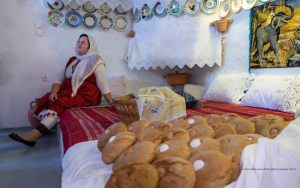 """Anastasoula Mpoli traditional singer of Archangelos Rhodes... she is singing in Serafi nostos-home. It took place during the workshop: """"Traditional wedding's sweet melekouni and bread of the Archangelos village""""."""